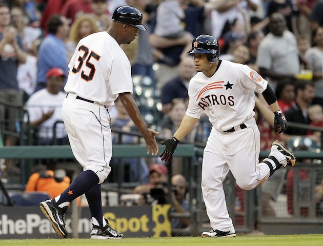 HOUSTON, TX - MAY 04 : Jose Altuve #27 of the Houston Astros receives congratulations from third base coach Dave Clark after hitting a three run home run in the second inning against the St. Louis Cardinals on May 4, 2012 at Minute Maid Park in Houston, Texas.   (Photo by Bob Levey/Getty Images)