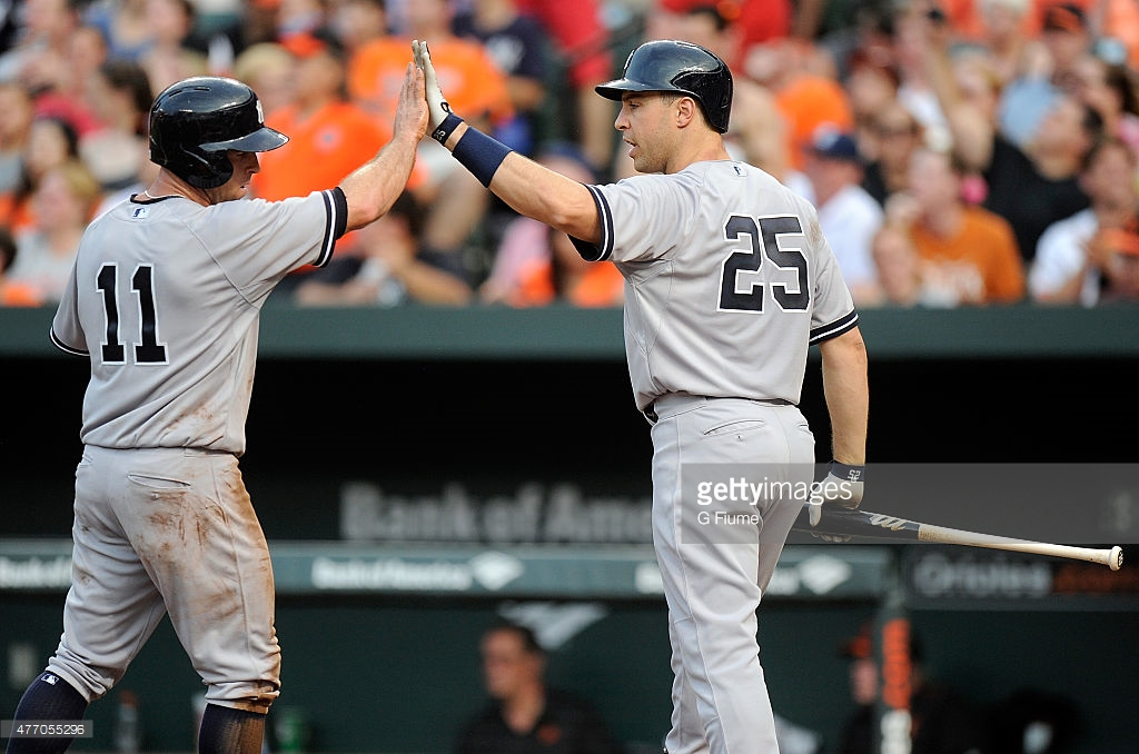 BALTIMORE, MD - JUNE 12:  Brett Gardner #11 of the New York Yankees celebrates with Mark Teixeira #25 after scoring against the Baltimore Orioles at Oriole Park at Camden Yards on June 12, 2015 in Baltimore, Maryland.  (Photo by G Fiume/Getty Images)
