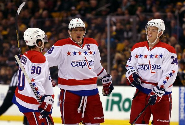 BOSTON, MA - MARCH 01:  Alex Ovechkin #8 of the Washington Capitals celebrates a second period goal with Marcus Johansson #90 and John Carlson #74 against the Boston Bruins during a game at the TD Garden on March 1, 2014 in Boston, Massachusetts.  (Photo by Alex Trautwig/Getty Images)