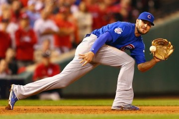 ST LOUIS, MO - OCTOBER 10: Kris Bryant #17 of the Chicago Cubs fields a ground ball in the ninth inning against the St. Louis Cardinals during game two of the National League Division Series at Busch Stadium on October 10, 2015 in St Louis, Missouri. (Photo by Dilip Vishwanat/Getty Images)