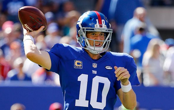 EAST RUTHERFORD, NJ - SEPTEMBER 20: Eli Manning #10 of the New York Giants attempts a pass in the third quarter against the Atlanta Falcons at MetLife Stadium on September 20, 2015 in East Rutherford, New Jersey. (Photo by Al Bello/Getty Images)