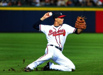 ATLANTA, GA - JUNE 17: Andrelton Simmons #19 of the Atlanta Braves attempts to throw out a runner at first base during the ninth inning against the Philadelphia Phillies at Turner Field on June 17, 2014 in Atlanta, Georgia. (Photo by Scott Cunningham/Getty Images)