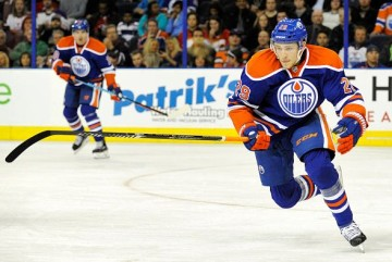EDMONTON , AB - SEPTEMBER 21: Leon Draisaitl #29 of the Edmonton Oilers chases a loose puck against the Calgary Flames at Rexall Place on September 21, 2015 in Edmonton, Alberta, Canada.(Photo by Dan Riedlhuber/Getty Images)
