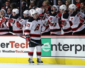 CHICAGO, IL - NOVEMBER 12: Kyle Palmieri #21 of the New Jersey Devils is congratulated by teammates after scoring a second period goal against the Chicago Blackhawks at the United Center on November 12, 2015 in Chicago, Illinois. (Photo by Jonathan Daniel/Getty Images)