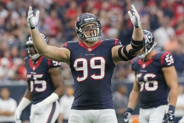 HOUSTON, TX - SEPTEMBER 27: J.J. Watt #99 of the Houston Texans pumps up the crowd while playing against the Tampa Bay Buccaneers in the first quarter on September 27, 2015 at NRG Stadium in Houston, Texas. (Photo by Thomas B. Shea/Getty Images)