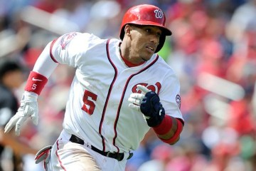 WASHINGTON, DC - SEPTEMBER 20: Yunel Escobar #5 of the Washington Nationals runs to first base against the Miami Marlins at Nationals Park on September 20, 2015 in Washington, DC. (Photo by G Fiume/Getty Images)