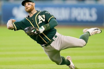 HOUSTON, TX - SEPTEMBER 20: Brett Lawrie #15 of the Oakland Athletics attempts to throw out Jed Lowrie #8 of the Houston Astros at Minute Maid Park on September 20, 2015 in Houston, Texas. (Photo by Bob Levey/Getty Images)