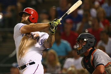 ARLINGTON, TX - SEPTEMBER 30: Mike Napoli #25 of the Texas Rangers hits a two-run homerun against the Detroit Tigers in the third inning at Globe Life Park in Arlington on September 30, 2015 in Arlington, Texas. (Photo by Ronald Martinez/Getty Images)