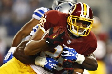 ARLINGTON, TX - OCTOBER 13: Jordan Reed #86 of the Washington Redskins is tackled during a game against the Dallas Cowboys at AT&T Stadium on October 13, 2013 in Arlington, Texas. (Photo by Wesley Hitt/Getty Images)