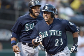OAKLAND, CA - JULY 03: Nelson Cruz #23 and Robinson Cano #22 of the Seattle Mariners celebrates after Cruz hit a two-run homer against the Oakland Athletics in the top of the eighth inning at O.co Coliseum on July 3, 2015 in Oakland, California. The Mariners won the game 9-5. (Photo by Thearon W. Henderson/Getty Images)