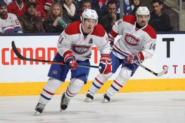 TORONTO, ON - JANUARY 23: Brendan Gallagher #11 and Tomas Plekanec #14 of the Montreal Canadiens skate against the Toronto Maple Leafs during an NHL game at the Air Canada Centre on January 23,2016 in Toronto, Ontario, Canada. The Canadiens defeated the Maple Leafs 3-2 in an overtime shoot-out. (Photo by Claus Andersen/Getty Images)