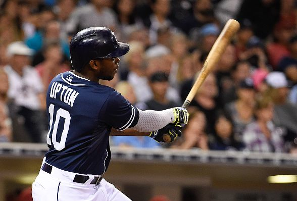 SAN DIEGO, CA - SEPTEMBER 26: Justin Upton #10 of the San Diego Padres hits an RBI double during the eighth inning of a baseball game against the Arizona Diamondbacks at Petco Park September 26, 2015 in San Diego, California. (Photo by Denis Poroy/Getty Images)