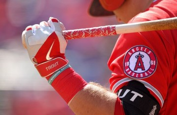 ARLINGTON, TX - OCTOBER 3: A detailed view of Nike batting gloves worn by Mike Trout #27 of the Los Angeles Angels of Anaheim during the game against the Texas Rangers at Globe Life Park in Arlington on October 3, 2015 in Arlington, California. (Photo by Matt Brown/Angels Baseball LP/Getty Images)
