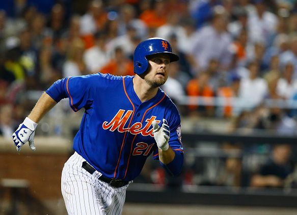 NEW YORK, NY - SEPTEMBER 18: Lucas Duda #21 of the New York Mets hits a double in the fourth inning against the New York Yankees during their game at Citi Field on September 18, 2015 in New York City. (Photo by Al Bello/Getty Images)