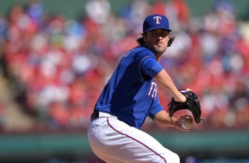 ARLINGTON, TX - OCTOBER 4: Cole Hamels #35 of the Texas Rangers pitches during the seventh inning of the game against the Los Angeles Angels of Anaheim at Globe Life Park in Arlington on October 4, 2015 in Arlington, California. (Photo by Matt Brown/Angels Baseball LP/Getty Images)