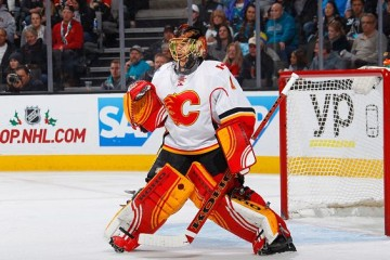 SAN JOSE, CA - NOVEMBER 28: Jonas Hiller #1 of the Calgary Flames protects the net against the San Jose Sharks at SAP Center on November 28, 2015 in San Jose, California. (Photo by Rocky W. Widner/NHL/Getty Images)