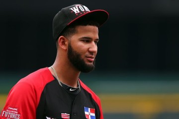 CINCINNATI, OH - JULY 12: Nomar Mazara #12 of the World Team looks on during batting practice ahead of the SiriusXM All-Star Futures Game at the Great American Ball Park on July 12, 2015 in Cincinnati, Ohio. (Photo by Elsa/Getty Images)