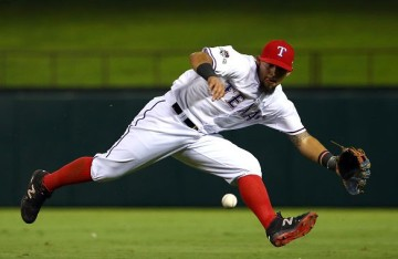 ARLINGTON, TX - OCTOBER 11: Rougned Odor #12 of the Texas Rangers fields a diving catch in the seventh inning against the Toronto Blue Jays during game three of the American League Division Series on October 11, 2015 in Arlington, Texas. (Photo by Tom Pennington/Getty Images)