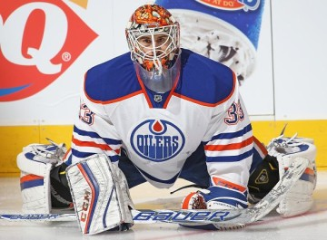TORONTO, ON - NOVEMBER 30: Cam Talbot #33 of the Edmonton Oilers stretches during the warm-up prior to play against the Toronto Maple Leafs during an NHL game at Air Canada Centre on November 30, 2015 in Toronto, Ontario, Canada. The Maple Leafs defeated the Oilers 3-0. (Photo by Claus Andersen/Getty Images)