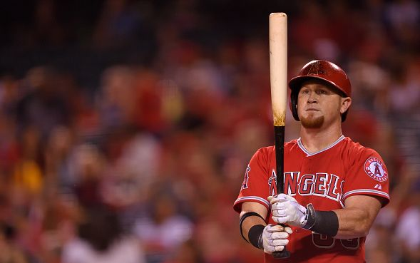 ANAHEIM, CA - SEPTEMBER 25: Kole Calhoun #56 of the Los Angeles Angels of Anaheim looks at his bat while at bat during the game against the Seattle Mariners at Angel Stadium of Anaheim on September 25, 2015 in Anaheim, California. (Photo by Matt Brown/Angels Baseball LP/Getty Images)