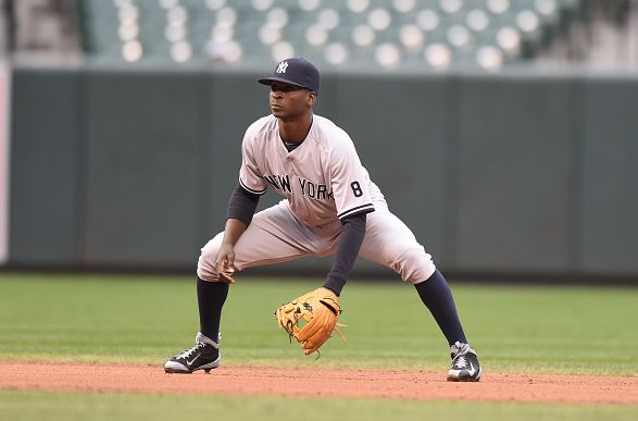 BALTIMORE, MD - OCTOBER 03: Didi Gregorius #18 of the New York Yankees in position during game one of a baseball game against the Baltimore Orioles at Oriole Park at Camden Yards on October 3, 2015 in Baltimore, Maryland. The Orioles won 9-2. (Photo by Mitchell Layton/Getty Images)