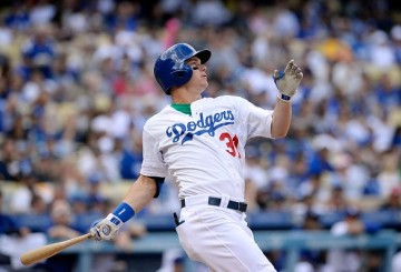 LOS ANGELES, CA - OCTOBER 4: Joc Pederson #31 of the Los Angeles Dodgers looks at his two-run home run that also scored A.J. Ellis #17 against the San Diego Padres during the second inning at Dodger Stadium October 4, 2015, in Los Angeles, California. (Photo by Kevork Djansezian/Getty Images)