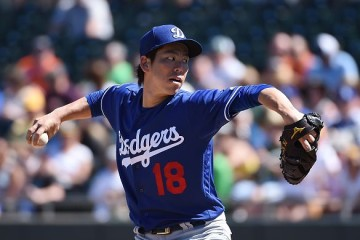 MESA, AZ - MARCH 10: Kenta Maeda #18 of the Los Angeles Dodgers delivers a pitch against the Oakland Athletics at HoHoKam Stadium on March 10, 2016 in Mesa, Arizona. (Photo by Norm Hall/Getty Images)