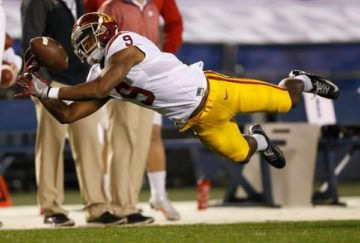 SAN DIEGO, CA - DECEMBER 30: JuJu Smith-Schuster #9 of the USC Trojans can't control this pass during the first quarter of a game against the Wisconsin Badgers during the National University Holiday Bowl at Qualcomm Stadium on December 30, 2015 in San Diego, California. (Photo by Sean M. Haffey/Getty Images)