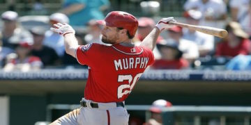 Mar 15, 2016; Kissimmee, FL, USA; Washington Nationals second baseman Daniel Murphy (20) hits a 2 run double during the third inning of a spring training baseball game against the Houston Astros at Osceola County Stadium. Mandatory Credit: Reinhold Matay-USA TODAY Sports